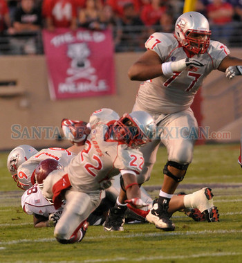 http://santafenewmexican.smugmug.com/Daily-news-photo-gallery/UNM-vs-NMSU/19307996_3ggCMp/1508219992_NM4NXLR#!i=1508219992&k=NM4NXLR