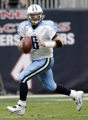 HOUSTON, TX - JANUARY 01:  Quarterback Matt Hasselbeck #8 of the Tennessee Titans looks downfield as he is pressured out of the pocket against the Houston Texans at Reliant Stadium on January 1, 2012 in Houston, Texas.  (Photo by Bob Levey/Getty Images)