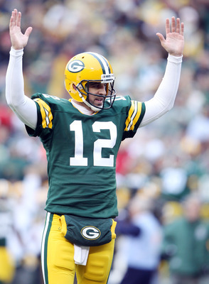 Rodgers reacts to throwing a touchdown.