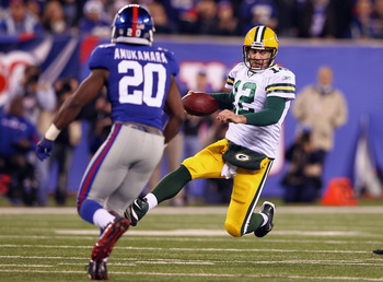 Amukamara chases down Aaron Rodgers in a game against the Green Bay Packers.
