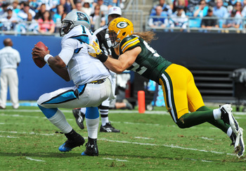 CHARLOTTE, NC - SEPTEMBER 18:  Linebacker Clay Matthews #52 of the Green Bay Packers sacks quarterback Cam Newton #1 of the Carolina Panthers  September 18, 2011 at Bank of America Stadium in Charlotte, North Carolina.  (Photo by Al Messerschmidt/Getty Im
