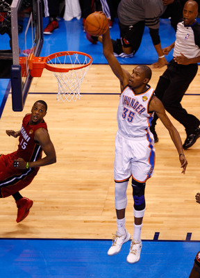 OKLAHOMA CITY, OK - JUNE 12:  Kevin Durant #35 of the Oklahoma City Thunder dunks the ball in the fourth quarter against the Miami Heat in Game One of the 2012 NBA Finals at Chesapeake Energy Arena on June 12, 2012 in Oklahoma City, Oklahoma. NOTE TO USER