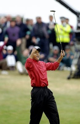 Tiger Woods reacts to making a birdie at the 1998 British Open. Woods would finish third in the event.