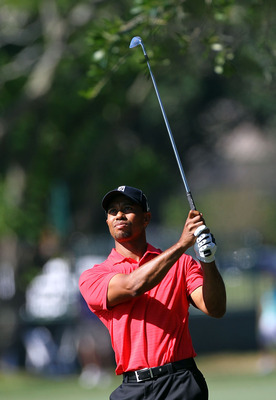 Tiger Woods drives the ball in the final round of the Arnold Palmer Invitational at Bay Hill. Woods would win the event by five strokes for his first official win since 2009.