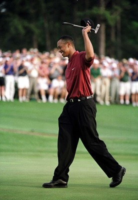 Tiger Woods celebrates after winning the 2001 Masters. With the win, Woods became the first player to hold all four current major championships at once.