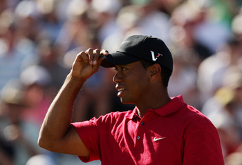 Tiger Woods adjusts his cap at the 2009 Australian Masters, the last tournament he would play in before his personal life imploded.