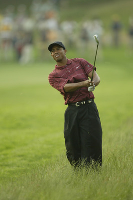 Tiger Woods watches his approach shot at the 2002 US Open, which he would win for his eighth total major in just seven seasons.