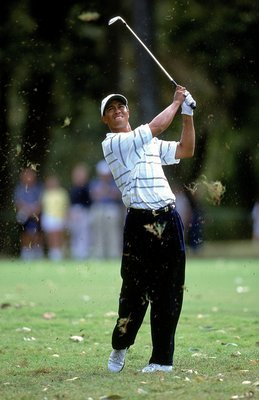 Tiger Woods chips a ball out of the rough during the 1999 Tour Championship. Woods finished inside the top ten a total of sixteen times in 1999, a total that included eight wins including one here.