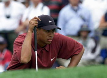 Tiger Woods eyes a putt at the 2000 US Open. In what was arguably his greatest major performance to date, Woods won the tournament by fifteen strokes, setting a new record for margin of victory in a major which has yet to be matched.
