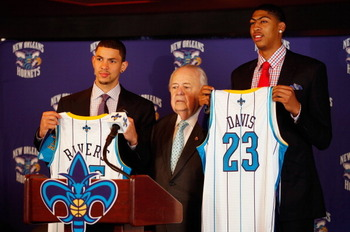 NEW ORLEANS, LA - JUNE 29:  Austin Rivers #25, team owner Tom Benson, and Anthony Davis #23 of the New Orleans Hornets pose as they are introduced to the media at the New Orleans Areana on June 29, 2012 in New Orleans, Louisiana. Davis was the first overa