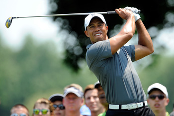BETHESDA, MD - JUNE 28:  Tiger Woods hits a tee shot on the second hole during Round One of the AT&T National at Congressional Country Club on June 28, 2012 in Bethesda, Maryland.  (Photo by Patrick McDermott/Getty Images)