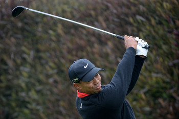 SAN FRANCISCO, CA - JUNE 17:  Tiger Woods of the United States hits his tee shot on the first hole during the final round of the 112th U.S. Open at The Olympic Club on June 17, 2012 in San Francisco, California.  (Photo by Harry How/Getty Images)