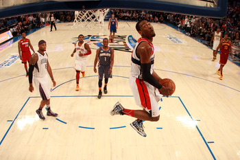 Wall, 21, dunks during the BBVA Rising Stars Challenge.