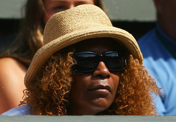 Oracene watches her daughter at Wimbledon