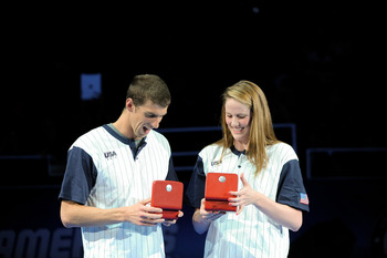 OMAHA, NE - JULY 2: Michael Phelps and Missy Franklin react after receiving their Omega watches for Male and Female swimmer of the meet after day eight of the 2012 U.S. Olympic Swimming Team Trials at the CenturyLink Center July 2, 2012 in Omaha, Nebraska