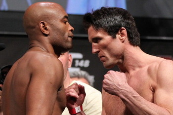 Anderson Silva (L) faces off with Chael Sonnen (Josh Hedges/Zuffa, LLC)