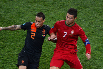 Gregory Van Der Wiel and Cristiano Ronaldo: Netherlands VS Portugal Euro 2012 Tournament