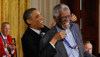 Bill Russell receives the Presidential Medal of Freedom from President Obama, as Stan Musial applauds in the background.