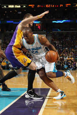 NEW ORLEANS, LA - APRIL 09:  Carl Landry #24 of the New Orleans Hornets drives the ball around Josh McRoberts #6 of the Los Angeles Lakers rleans, Louisiana.   NOTE TO USER: User expressly acknowledges and agrees that, by downloading and or using this pho