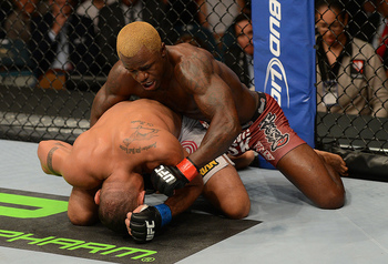 LAS VEGAS, NV - JULY 7: Melvin Guillard (top) punches Fabricio Camoes during their lightweight bout at UFC 148 inside MGM Grand Garden Arena on July 7, 2012 in Las Vegas, Nevada. (Photo by Donald Miralle/Zuffa LLC/Zuffa LLC via Getty Images)