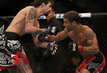 LAS VEGAS, NV - JULY 7: (R-L) Chad Mendes punches Cody McKenzie during their featherweight bout at UFC 148 inside MGM Grand Garden Arena on July 7, 2012 in Las Vegas, Nevada. (Photo by Josh Hedges/Zuffa LLC/Zuffa LLC via Getty Images)