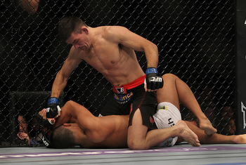 LAS VEGAS, NV - JULY 7: Demian Maia (top) punches Dong Hyun Kim during their welterweight bout at UFC 148 inside MGM Grand Garden Arena on July 7, 2012 in Las Vegas, Nevada. (Photo by Josh Hedges/Zuffa LLC/Zuffa LLC via Getty Images)