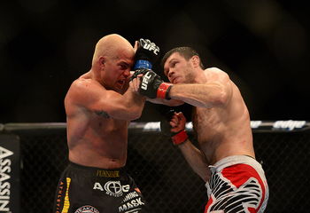 Jul. 7, 2012; Las Vegas, NV, USA; UFC fighter Forrest Griffin (right) punches Tito Ortiz during a light heavyweight bout in UFC 148 at the MGM Grand Garden Arena. Mandatory Credit: Mark J. Rebilas-US PRESSWIRE