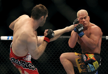 LAS VEGAS, NV - JULY 7: (L-R) Forrest Griffin kicks Tito Ortiz during their light heavyweight bout at UFC 148 inside MGM Grand Garden Arena on July 7, 2012 in Las Vegas, Nevada. (Photo by Josh Hedges/Zuffa LLC/Zuffa LLC via Getty Images)