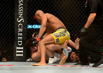 Jul. 7, 2012; Las Vegas, NV, USA; UFC fighter Anderson Silva (top) punches Chael Sonnen during a middleweight bout in UFC 148 at the MGM Grand Garden Arena. Mandatory Credit: Mark J. Rebilas-US PRESSWIRE