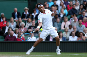 LONDON, ENGLAND - JUNE 30:  Marcos Baghdatis of Cyprus returns a shot during his Gentlemen's Singles third round match against Andy Murray of Great Britain on day six of the Wimbledon Lawn Tennis Championships at the All England Lawn Tennis and Croquet Cl