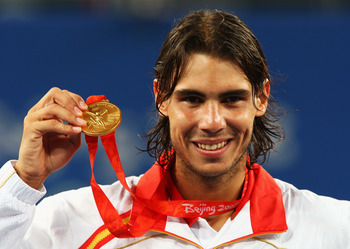 BEIJING - AUGUST 17:  Rafael Nadal of Spain celebrates winning the gold medal against Fernando Gonzalez of Chile during the men's singles gold medal tennis match held at the Olympic Green Tennis Center during Day 9 of the Beijing 2008 Olympic Games on Aug
