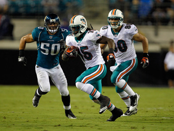 JACKSONVILLE, FL - AUGUST 21:  Russell Allen #50 of the Jacksonville Jaguars attempts to tackle Davone Bess #15 of the Miami Dolphins during the preseason game at EverBank Field on August 21, 2010 in Jacksonville, Florida.  (Photo by Sam Greenwood/Getty I