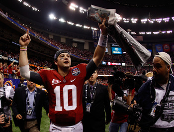 NEW ORLEANS, LA - JANUARY 09:  AJ McCarron #10 of the Alabama Crimson Tide celebrates after defeating Louisiana State University Tigers in the 2012 Allstate BCS National Championship Game at Mercedes-Benz Superdome on January 9, 2012 in New Orleans, Louis