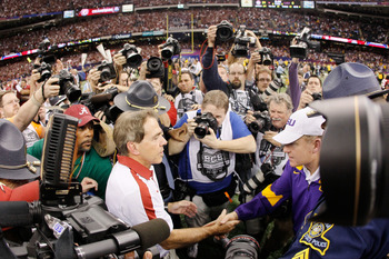 NEW ORLEANS, LA - JANUARY 09:  Head coach Nick Saban of the Alabama Crimson Tide shakes hands with head coach Les Miles of the Louisiana State University Tigers afterthe 2012 Allstate BCS National Championship Game at Mercedes-Benz Superdome on January 9,