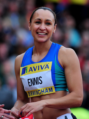 BIRMINGHAM, ENGLAND - JUNE 23:  Jessica Ennis of Great Britain celebrates looks on after winning the Women's 100 Metres Hurdles Final during day two of the Aviva 2012 UK Olympic Trials and Championship at Alexander Stadium on June 23, 2012 in Birmingham,
