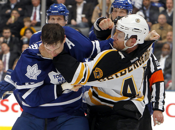 Armstrong pounds Seidenberg's fist with his face.
