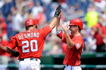 Ian Desmond hi-fives Adam LaRoche after hitting a home run.
