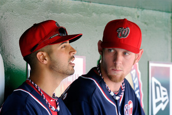 Stephen Strasburg and Gio Gonzalez talk while watching the Nationals beat the Giants on the Fourth of July.