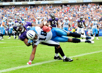 NASHVILLE, TN - SEPTEMBER 18:  Kenny Britt #18 of the Tennessee Titans scores a touchdown as Domonique Foxworth #24 of the Baltimore Ravens defends during the second quarter at LP Field on September 18, 2011 in Nashville, Tennessee.  (Photo by Grant Halve