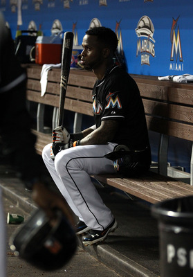 MIAMI, FL - JUNE 22: Jose reyes #7 of the Miami Marlins sita on the bench against the Toronto Blue Jays at Marlins Park on June 22, 2012 in Miami, Florida. Toronto defeated Miami 12-5.  (Photo by Marc Serota/Getty Images)