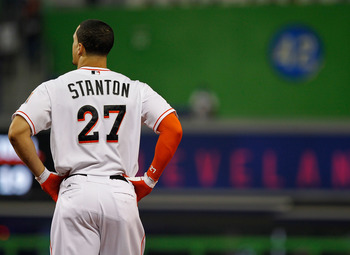 MIAMI, FL - JUNE 25: Giancarlo Stanton #27 of the Miami Marlins reacts to striking out during a game against the St. Louis Cardinals at Marlins Park on June 25, 2012 in Miami, Florida.  (Photo by Mike Ehrmann/Getty Images)