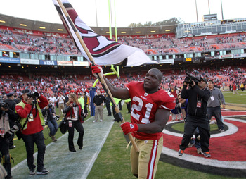 Frank Gore celebrates after a victory against the Rams