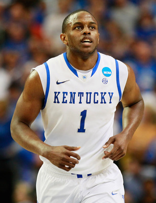 Former Kentucky star Darius Miller walks down the court during NCAA tournament. He will join Wildcat teammate Anthony Davis on the Hornets' summer league roster.