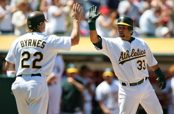 Former outfielders Eric Byrnes (left) and Nick Swisher (right)