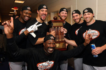 Giants players pose with the trophy they received after winning the 2010 NLCS.