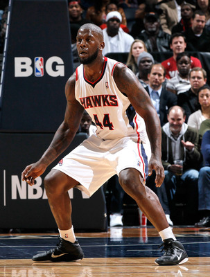ATLANTA, GA - JANUARY 05:  Ivan Johnson #44 of the Atlanta Hawks against the Miami Heat at Philips Arena on January 5, 2012 in Atlanta, Georgia.  NOTE TO USER: User expressly acknowledges and agrees that, by downloading and or using this photograph, User 