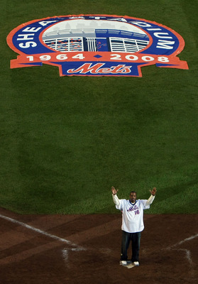 NEW YORK - SEPTEMBER 28:  Former Mets pitcher Dwight Gooden greets fans from the field in a post game ceremony after the last regular season baseball game ever played in Shea Stadium against the Florida Marlins on September 28, 2008 in the Flushing neighb