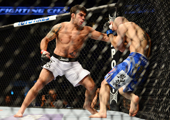 July 11, 2012; San Jose, CA, USA; Raphael Assuncao (left) fights Issei Tamura (right) during the bantamweight bout of the UFC on Fuel TV at HP Pavilion. Mandatory Credit: Kyle Terada-US PRESSWIRE