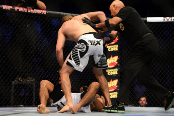 July 11, 2012; San Jose, CA, USA; Rafael Natal (bottom) fights Andrew Craig (top) during the middleweight bout of the UFC on Fuel TV at HP Pavilion. Mandatory Credit: Kyle Terada-US PRESSWIRE
