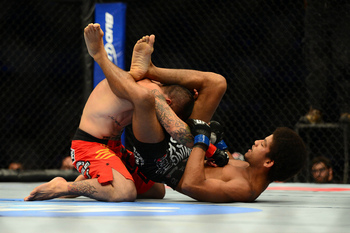 July 11, 2012; San Jose, CA, USA; Damacio Page (left) fights Alex Caceres (right) during the bantamweight bout of the UFC on Fuel TV at HP Pavilion. Mandatory Credit: Kyle Terada-US PRESSWIRE